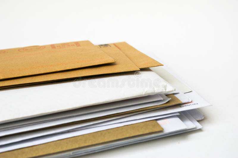 Stack of envelopes with copy space on a white background royalty free stock images