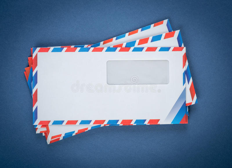 A stack of envelopes on a blue stock images