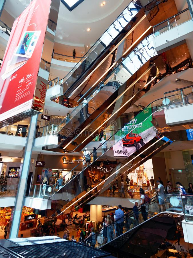 A Stack of Escalators in a Shopping Mall. A modern shopping mall, with a stack of escalators linking various level stock images