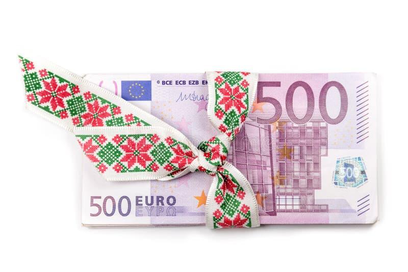 Stack of Euro banknotes with ribbon. 500 Euro banknotes. royalty free stock image