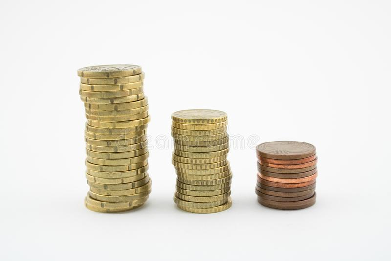 Stack of euro cents coins of different value on white background. Economy stock photography