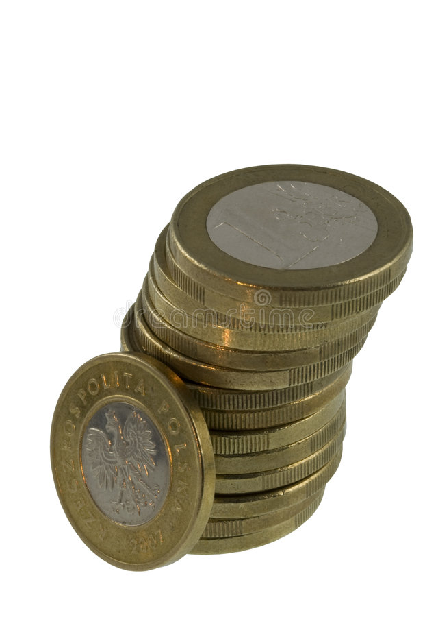Stack Of Euro Coins With A Single Polish One Aside Royalty Free Stock Photography