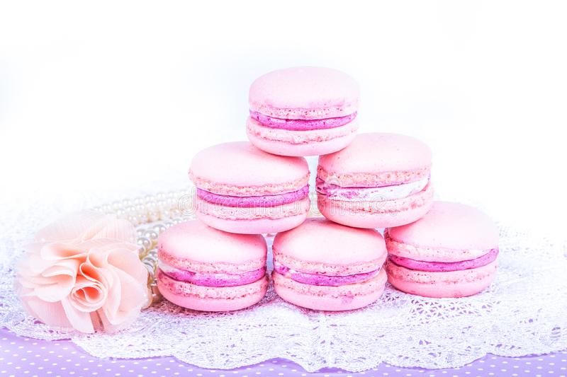 Stack of excellent airy macaroons. Stack of pink almond cakes on white background. Copy space royalty free stock photography