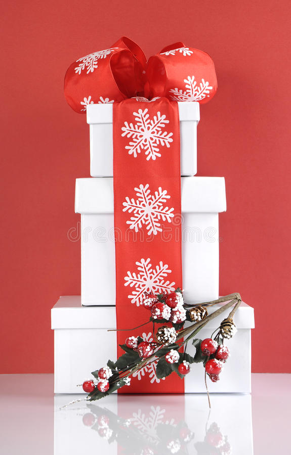 Stack of festive red and white theme Christmas gift boxes stock photography