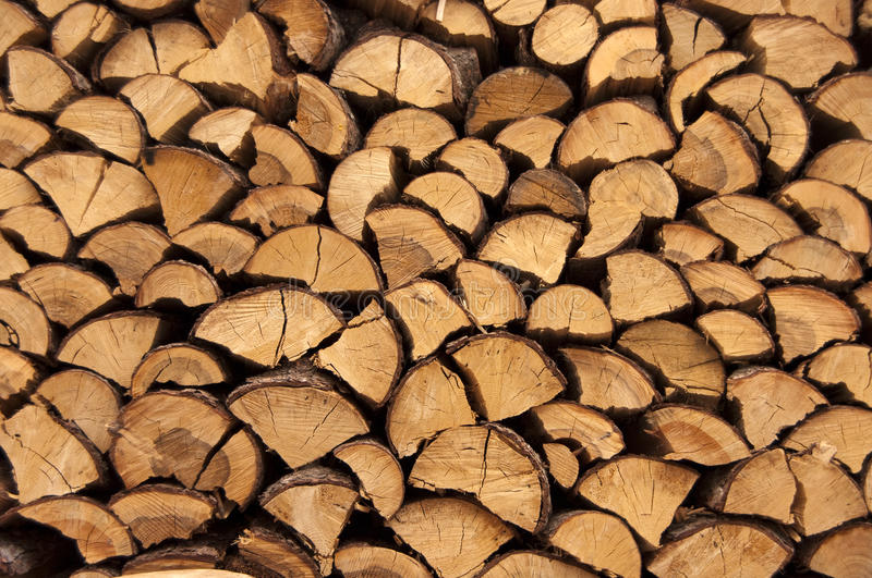 Stack of firewood. Close-up of a stack of firewood stock images