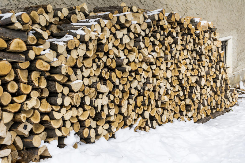 Stack of firewood in the snow royalty free stock photos