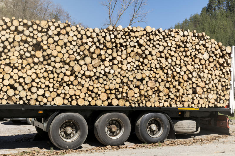 Stack of firewood on a truck royalty free stock image