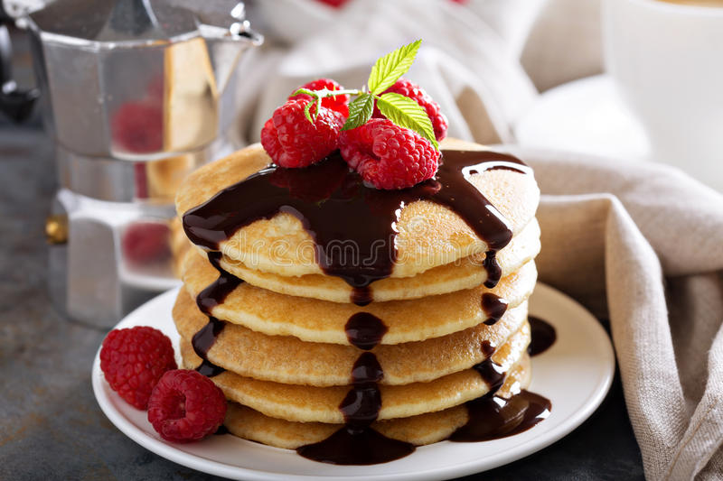 Stack of fluffy buttermilk pancakes with chocolate royalty free stock photo