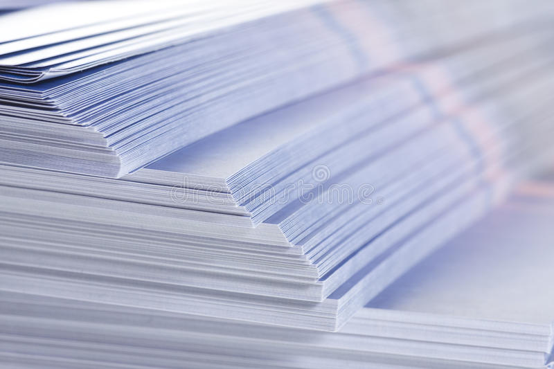 Stack of flyers. Selective focus stock photos