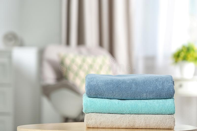 Stack of folded clean soft towels on table. Space for text. Stack of folded clean soft towels on table indoors. Space for text royalty free stock image