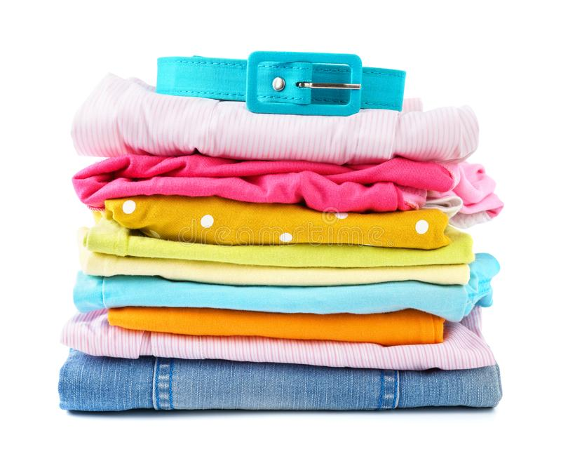 Stack of folded colorful clothes for children and teens royalty free stock photography