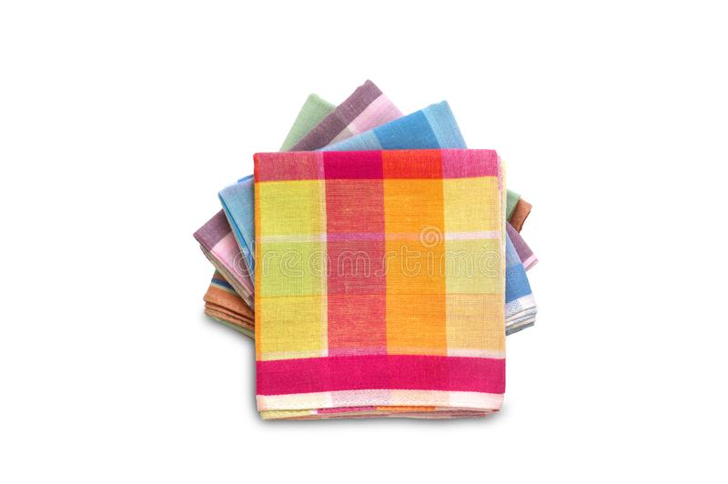 Stack of folded plaid handkerchiefs on white background. Stack of folded plaid handkerchiefs isolated on white background stock photography