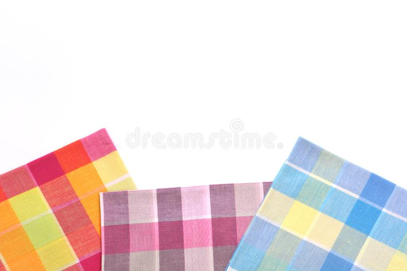 Stack of folded plaid handkerchiefs on white background. Stack of folded plaid handkerchiefs isolated on white background with copy space stock images