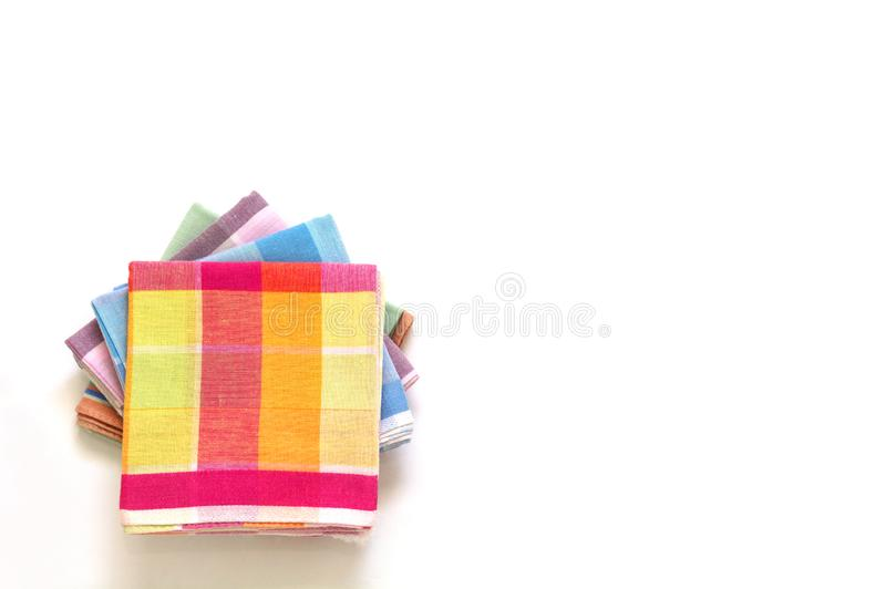 Stack of folded plaid handkerchiefs on white background royalty free stock photography