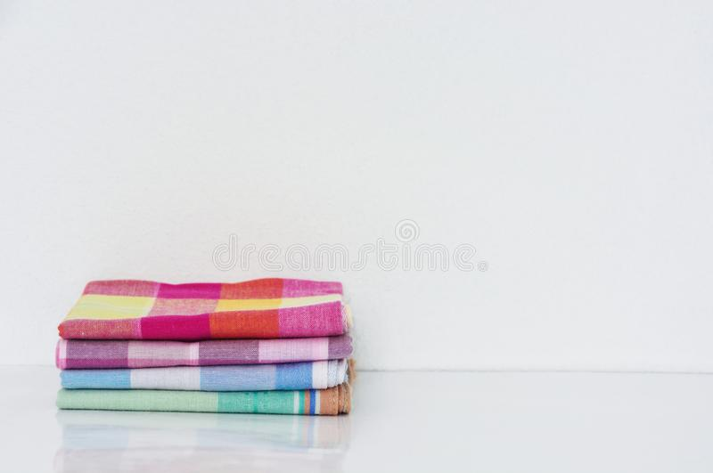 Stack of folded handkerchiefs on white background. Copy space stock image