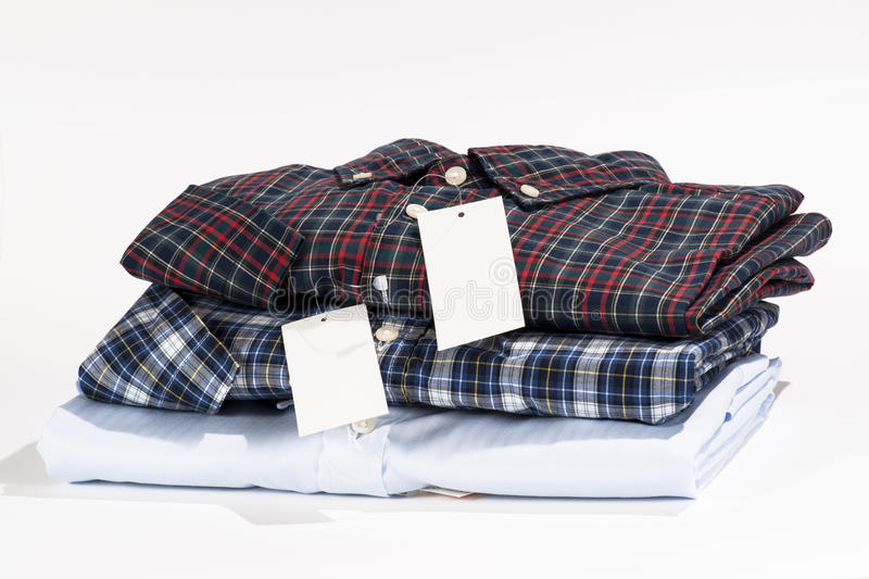 Stack of folded shirts. With blank label royalty free stock image