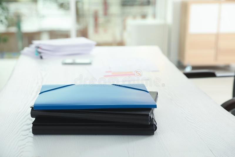 Stack of folders with documents on office table royalty free stock photo