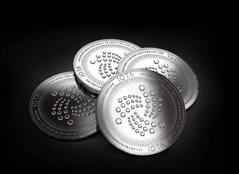 Stack of four silver IOTA coins laying on the black background stock illustration