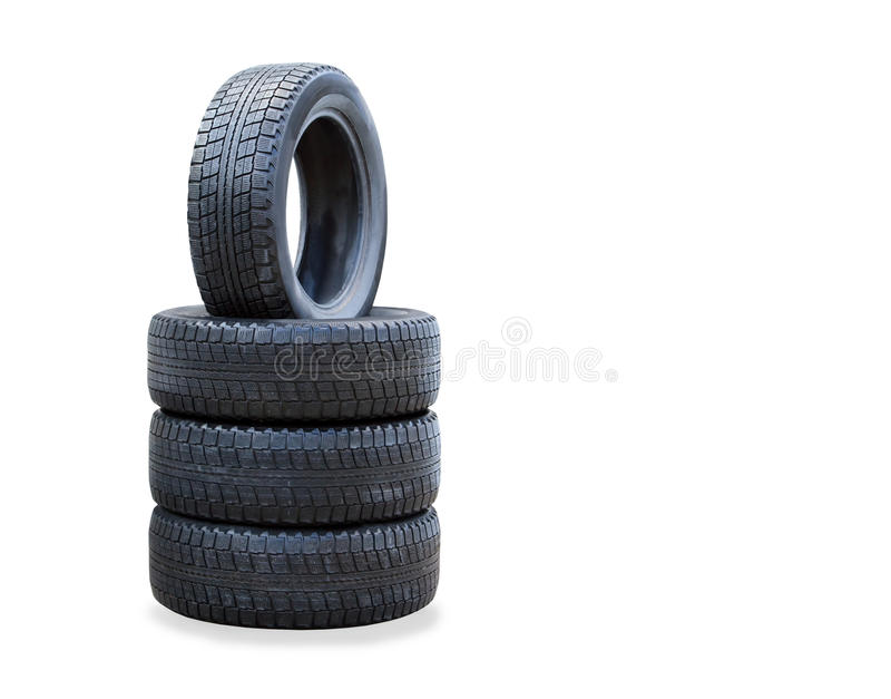 The stack of four winter new tires over white stock photos