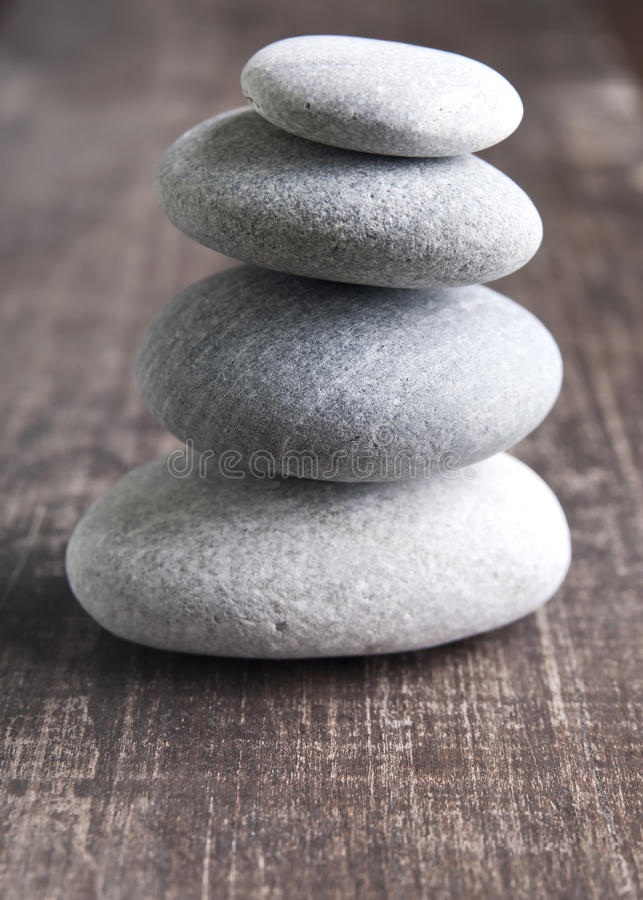 A stack of four zen rocks stock image