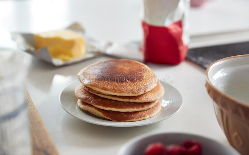 Stack Of Freshly Made Pancakes Or Crepes On Table For Pancake Day royalty free stock photo