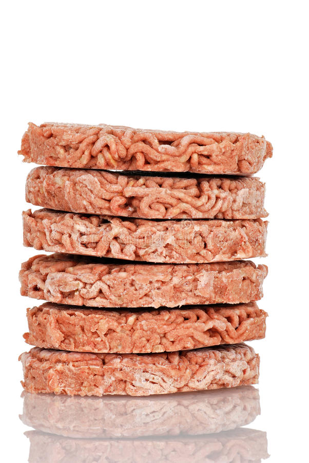 Stack of frozen hamburgers. With relfection royalty free stock image