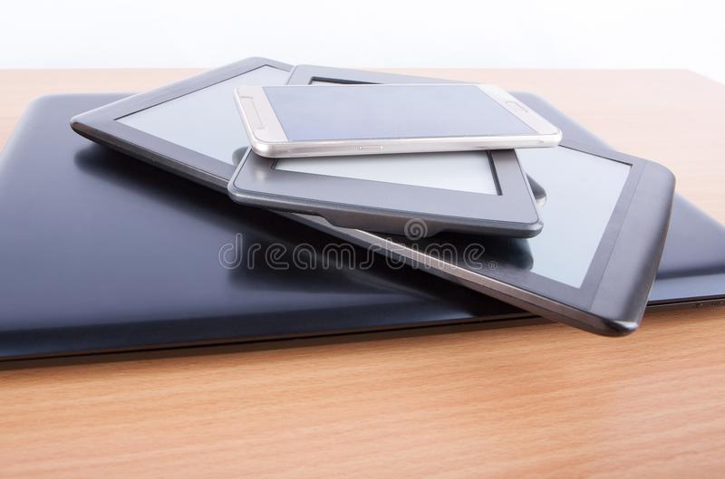 Stack of gadgets on an office desk stock photo