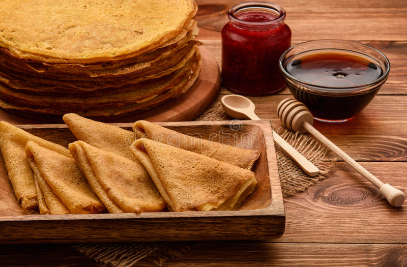 Stack of gluten free pancakes made from corn flour served with raspberry jam and maple syrup. Stack of gluten free pancakes made from corn flour served with stock photos