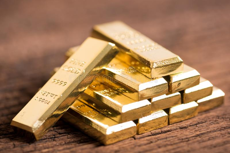 Stack of gold bar on wood background stock photo