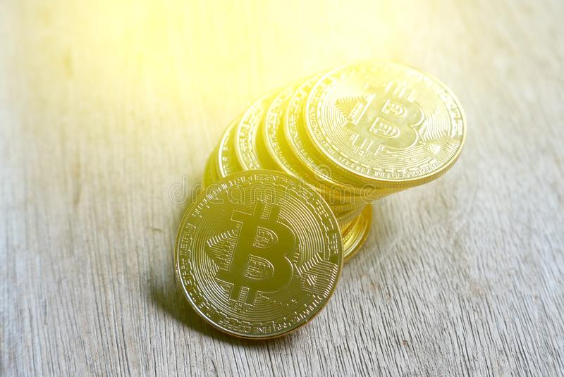Stack of golden bitcoin replica with sun flare.Business and finance concept. Stack of golden bitcoin replica with sun flare.Business and finance concept royalty free stock photos