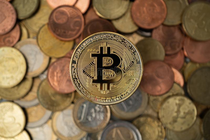 Golden Bitcoin On Stack Of Euro Coins Stock Image - Image of crypto, symbol: 104282585