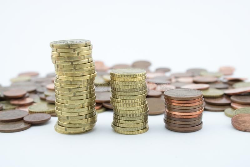 Stack of golden and bronze coins on white background. Coins of twenty euro cents stock photo