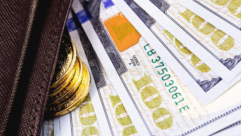 Metal coins and dollars banknotes. Stack golden metal coins and dollars banknotes in wallet closeup stock photo