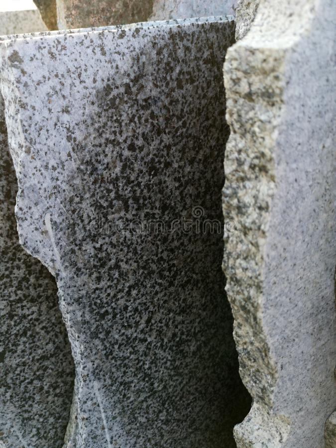 stack of granite slab - marble industry factory smooth surface sandstone grey background royalty free stock images