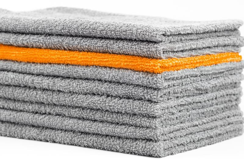 Stack of gray and Orange terry towels, conceptual background. Close-up stock image