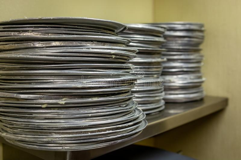 Stack of pizza pans stock photo