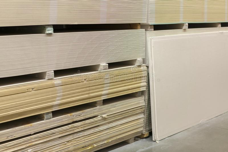 The stack of gypsum board preparing for construction. Gypsum plasterboard in the pack.  stock image
