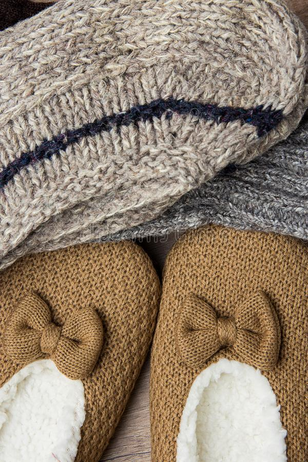 Stack of Handmade Warm Knitted Socks From Rough Wool Yarn Fluffy Fir Slippers Top View. Winter Autumn Eco Fashion Kinfolk. Style. Natural Materials royalty free stock photos