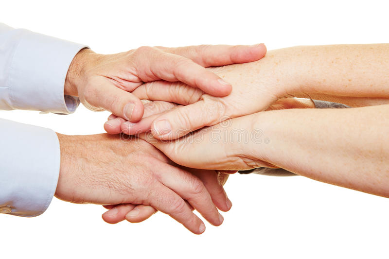 Stack Of Hands Of Senior People Royalty Free Stock Image