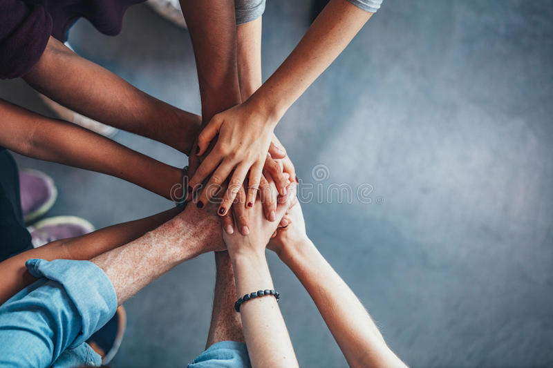 Stack of hands showing unity and teamwork royalty free stock photo