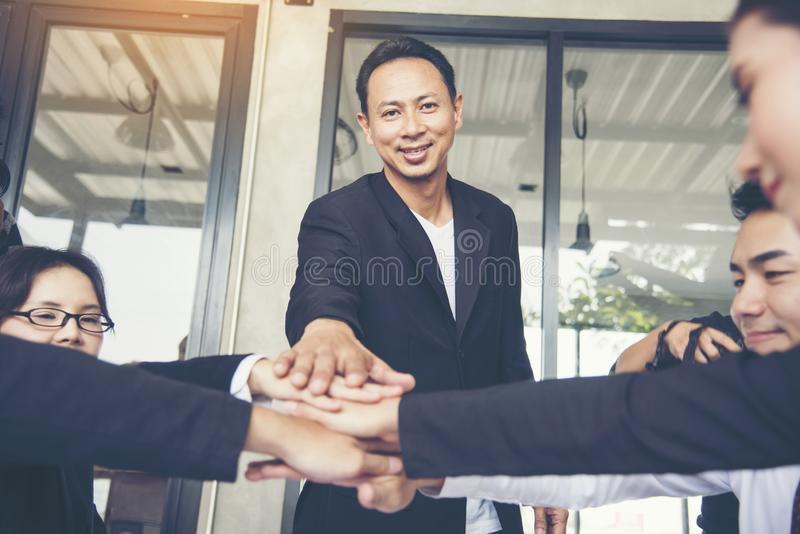 Stack hands team Teamwork Collaboration Team Meeting Communication concept with Business people Working Together. Poer of woman un stock image