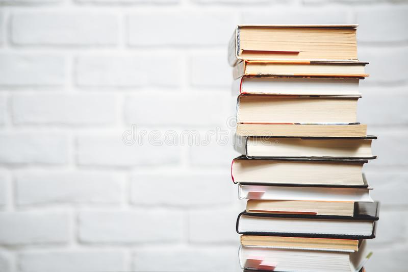 Stack of hardback books on wooden table. Back to school. Copy space for text.  stock photography