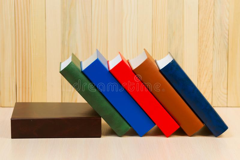 Stack of hardback books on wooden table. Back to school. Copy space royalty free stock image