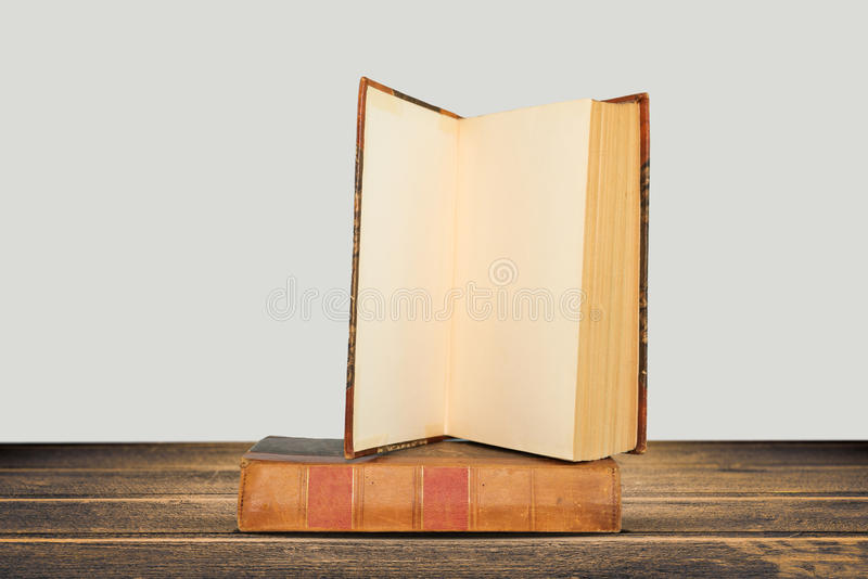 Download Stack Of Hardback Books On Wooden Table Stock Photo - Image: 83704586