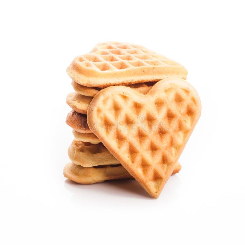 Stack of heart shaped waffles. Isolated on white background royalty free stock image