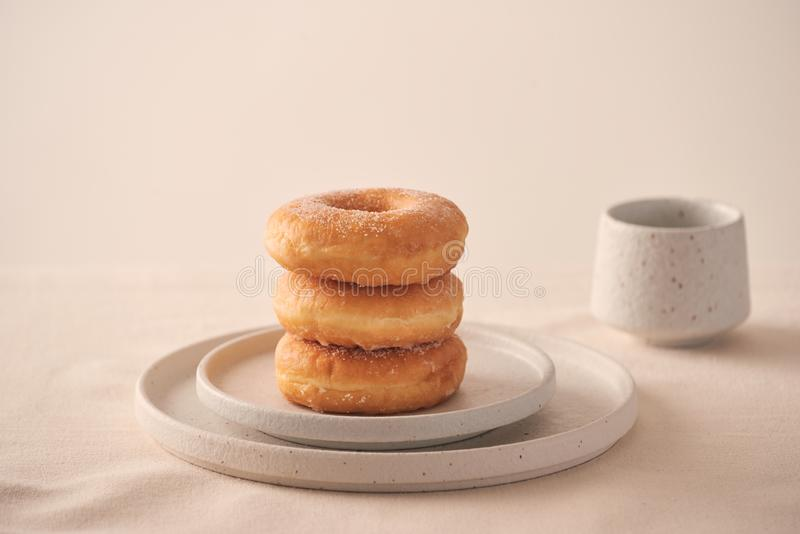 Stack of homemade baked donuts sitting on white plate royalty free stock photography