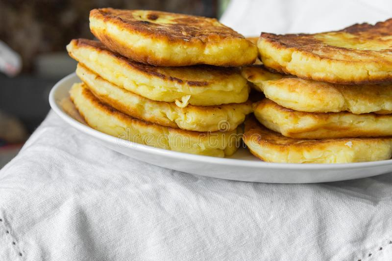 Stack of homemade mascarpone pancakes fritters on plate on white cotton tablecloth. Breakfast setting cozy homely atmosphere. Rustic style royalty free stock image