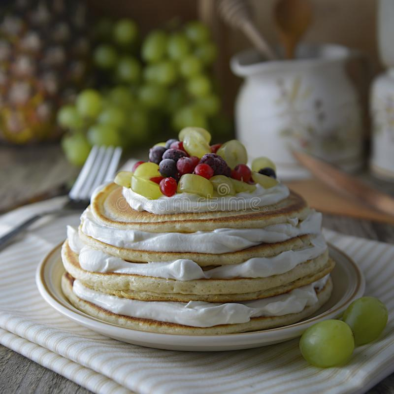 Stack of homemade pancakes or crepes with cream, yougurt fresh berries. Delicious breakfast. Pastry. Healthy food. stock photography