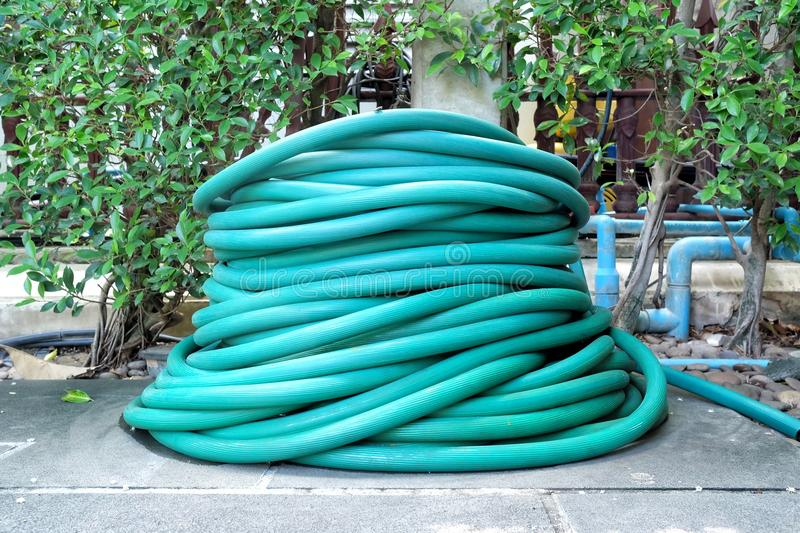 Stack of Hose in The Garden. royalty free stock photo