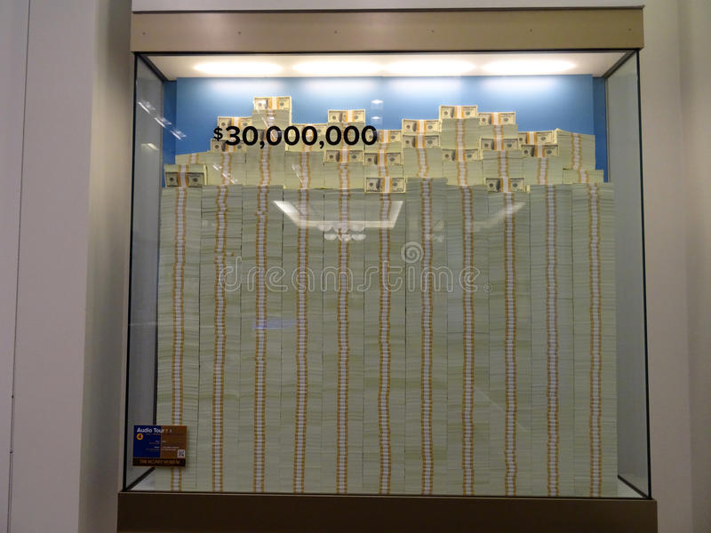 Stack of Hundred dollar bills in glass display case equally 30 m. DENVER, COLORADO - JULY 7: Stack of Hundred dollar bills in glass display case equally 30 royalty free stock photos
